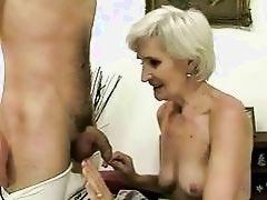 Hot mature enjoys sex with a boy