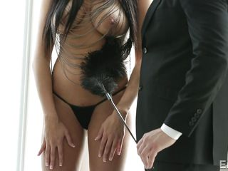 teasing her with a feather duster