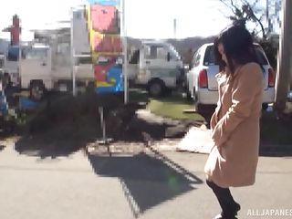 japanese babe flashes her inflexible tits on the road