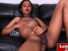 Tattooed unnatural girls wanks her hung cock solo