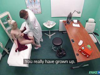 cute blonde sucks fake doctor's heavy jock