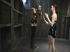 Lezdom scene with extensive use of bondage and a huge and cold ice block