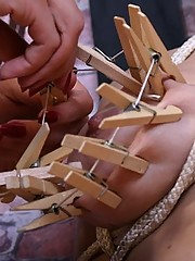 Two kinky girls using clothespins as sex toys in bondage fun