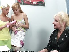 Kristina and Mira are having fun with an aged woman